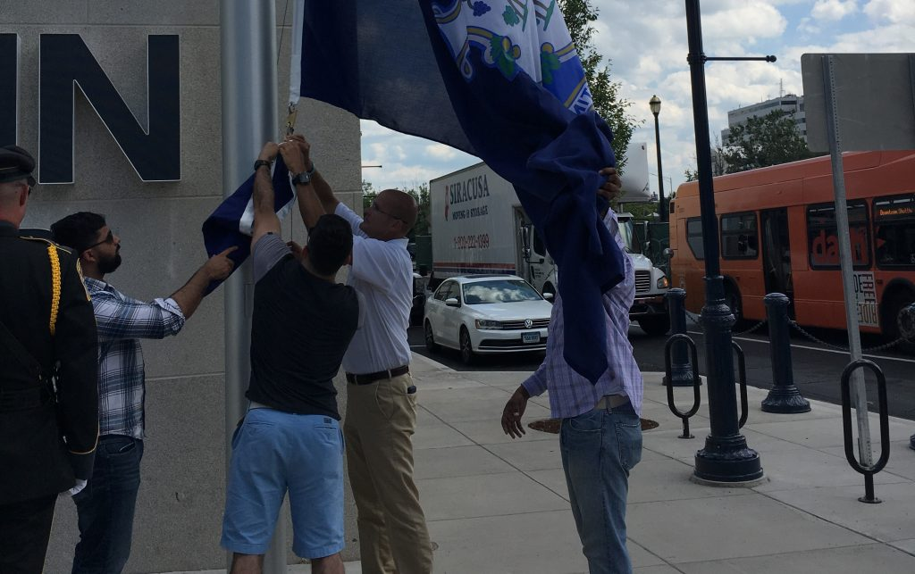 UConn Veterans raising the Connecticut flag at UConn Hartford campus in August 2017