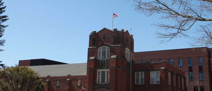 U.S. Flag raised on top of Hawley Armory, the location of UConn's Office of Veterans Affairs & Military Programs.