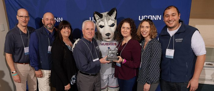 Veterans Affairs and Military Programs pose with Jonathan the Husky and their award following the UConn Spirit Awards ceremony held at Centennial Alumni House on March 28, 2019.